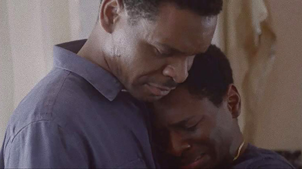 """Still from """"Beautiful Nightmare"""" by Kevin Lee Maxwell showing Kelechi Antwone Hugging. SFDFF 2021"""